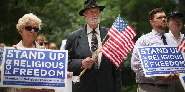 CHICAGO, IL - JUNE 30:  Religious freedom supporters hold a rally to praise the Supreme Court's decision in the Hobby Lobby,