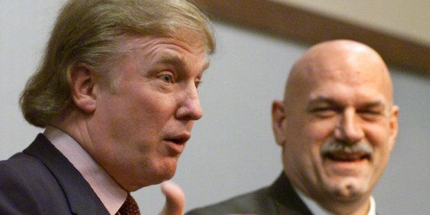 FILE - In this Jan. 7, 2007, file photo, potential Reform Party presidential candidate Donald Trump, left, speaks at a news c