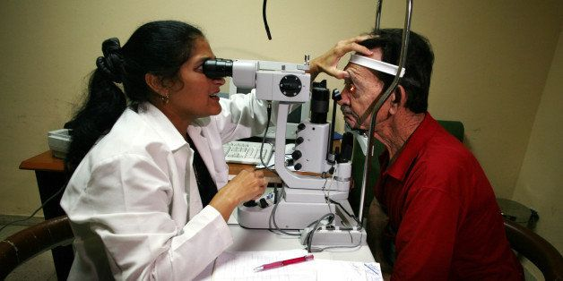 CUBA - SEPTEMBER 12:  A Cuban doctor looks the crystalline lens of a patient at the Pando Ferrer Eyes Hospital, a model hospi