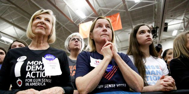 Supporters listen as Democratic presidential candidate Hillary Clinton speaks during a rally at Rainer Beach High School in S