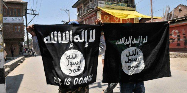 SRINAGAR, INDIA - JUNE 27: Kashmiri protesters displaying the flags of ISIS during a protest against alleged desecration of J