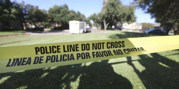 FILE - In this Oct. 15, 2014 file photo, police tape marks where the media is set up, in Dallas. Amid the national focus on d