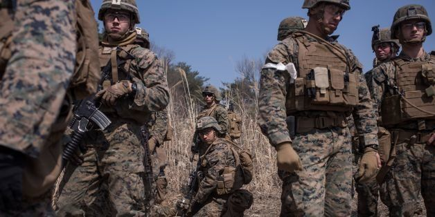 In a photo taken on March 15, 2016 US soldiers of the 31st Marine Expeditionary Unit infantry take part in a live fire drill
