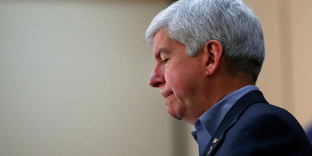 Gov. Rick Snyder speaks after attending a Flint Water Interagency Coordinating Committee meeting, Friday, Feb. 26, 2016 in Fl