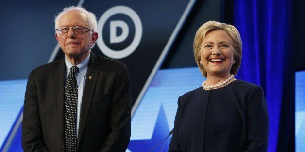 Democratic presidential candidates, Hillary Clinton and Sen. Bernie Sanders, I-Vt,  stand together before the start of the Un