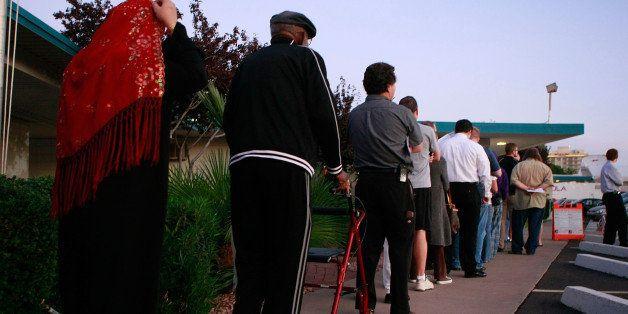 PHOENIX - NOVEMBER 4:  People line up to vote at the Albright United Methodist Church November 4, 2008 in Phoenix, Arizona. V