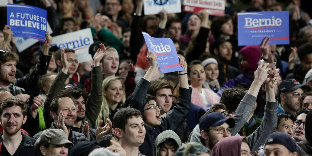 Supporters cheer as Democratic presidential candidate Bernie Sanders speaks during a rally at Safeco Field in Seattle on Marc
