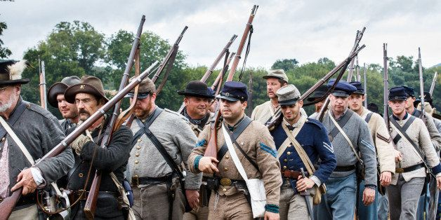 Confederate Soldiers in Military Uniform and With Rifles March to the Battlefield During the 150th Anniversary of the Histori