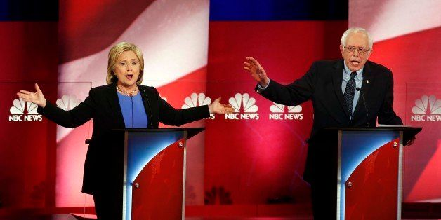 Democratic presidential candidates, former Secretary of State Hillary Clinton, left, and Sen. Bernie Sanders, I-Vt. talk over