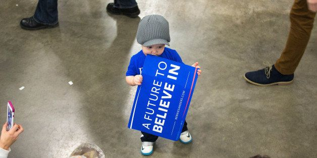 MADISON, WI - MARCH 26:  Nineteen-month-old Craig Fietzer waits with his mother for the arrival of Democratic presidential ca