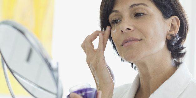 Woman applying eye cream