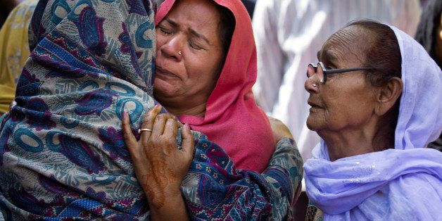 Women mourn the death of their family member who was killed in a suicide bombing, in Lahore, Pakistan, Monday, March 28, 2016