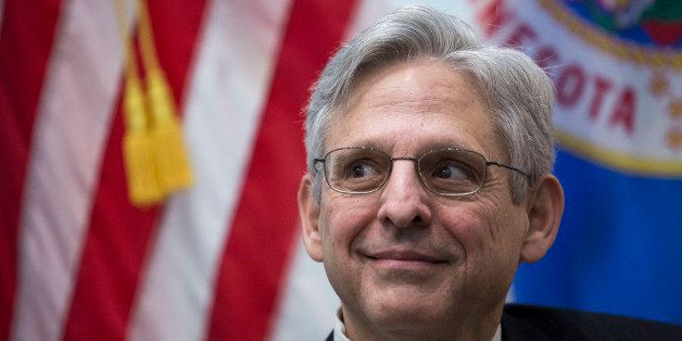 WASHINGTON, DC - MARCH 30: U.S. Supreme Court nominee Merrick Garland looks on during a photo opportunity before a private me