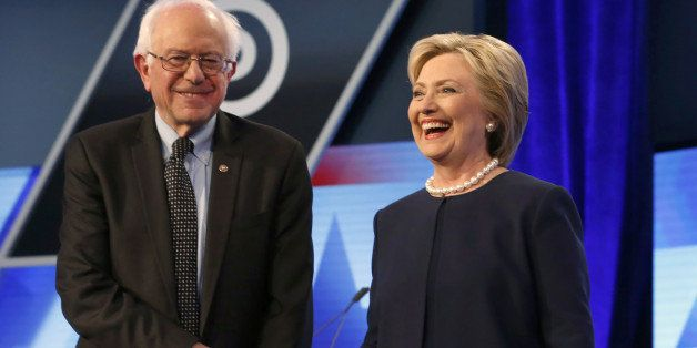 Democratic presidential candidates, Hillary Clinton and Sen. Bernie Sanders, I-Vt,  shake hands before the start of the Univi