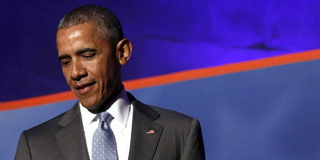 U.S. President Barack Obama arrives at the awards dinner for Syracuse University's Toner Prize for Excellence in Political Re