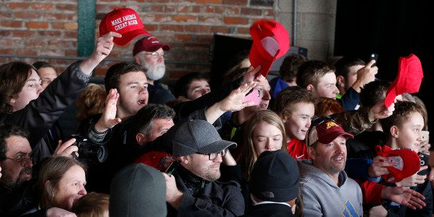 Supporters try to get the attention of Republican presidential candidate Donald Trump after he spoke Monday, April 4, 2016, d