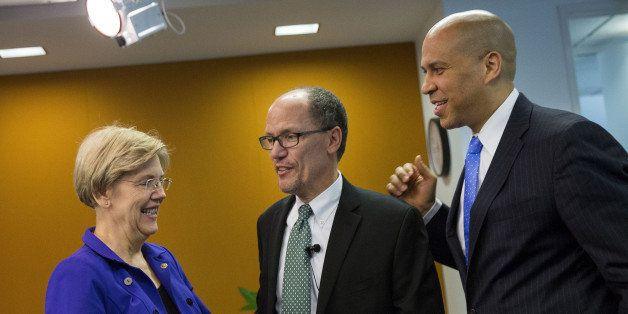 Senator Elizabeth Warren, a Democrat from Massachusetts, from left, Thomas Perez, U.S. Secretary of Labor, and Senator Cory B