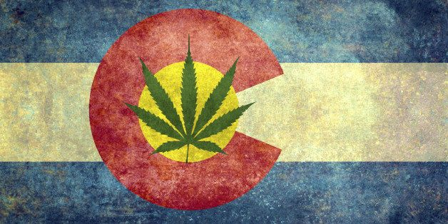 Vintage distressed retro version of the Colorado State flag with Marijuana leaf in center - controversial issue