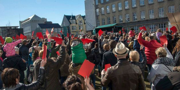 Thousands of Icelanders rally in Reykjavik on April 9, 2016 to demand immediate elections on a sixth consecutive day of anti-