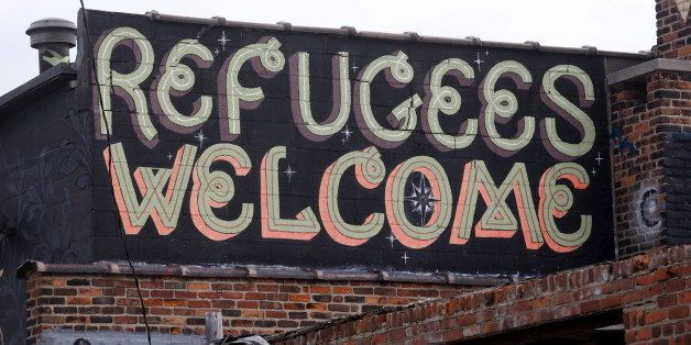 'Refugees Welcome' is seen painted on a building in a blighted area near downtown Detroit, Michigan November 17, 2015.    REU