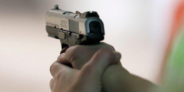 SALT LAKE CITY, UT - JANUARY 15:  A women fires a handgun at the 'Get Some Guns & Ammo' shooting range on January 15, 2013 in