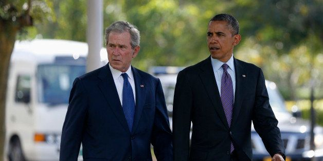U.S. President Barack Obama (R) and former President George W. Bush attend a memorial for the victims of the 1998 U.S. Embass