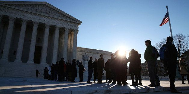 WASHINGTON, DC - JANUARY 11:  People wait in line to enter the US Supreme Court building January 11, 2016 in Washington, DC.