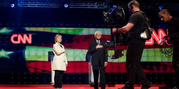 BROOKLYN, NY - Former Secretary of State Hillary Clinton and Senator Bernie Sanders appear on stage just before the CNN Democ