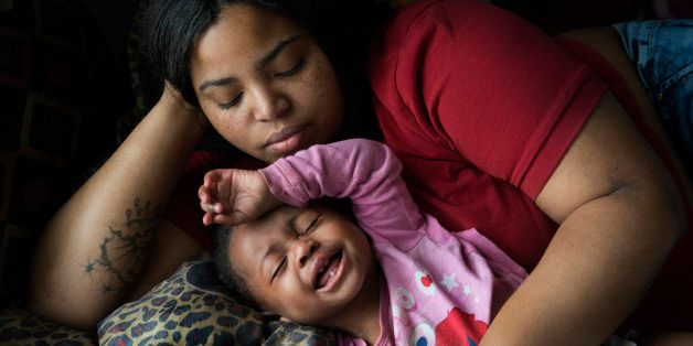 FLINT, MI - MARCH 1:    Nakeyja Cade with her one-year-old daughter Zariyah Cade whose blood has tested high for lead in Flin