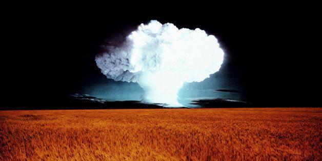 Wheat field, mushroom cloud on horizon (digital composite)