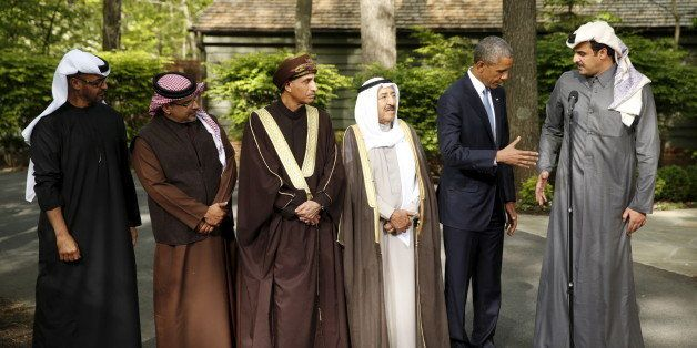 U.S. President Barack Obama shakes hands with the Emir of Qatar Sheikh Tameem bin Hamad Al Thani while hosting the six-nation