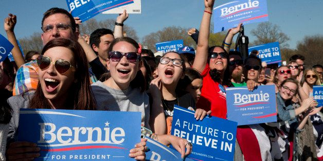 Supporters cheer as Democratic presidential candidate Bernie Sanders, I-Vt., speaks during a campaign rally in Prospect Park,
