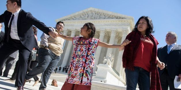Sophie Cruze (C), of Los Angeles, and other supporters of US President Barack Obama's immigration reforms leave the US Suprem