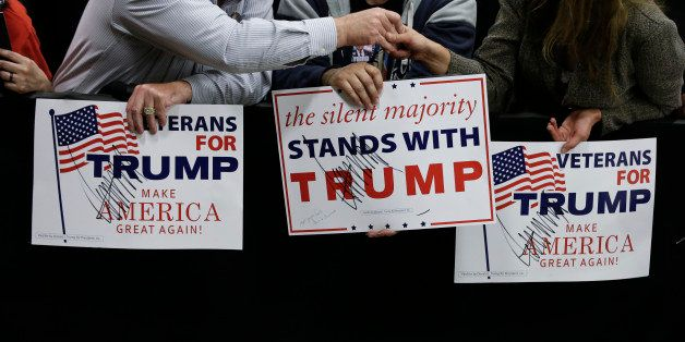 A supporter holds a sign after Republican presidential candidate Donald Trump speaks during a campaign stop Wednesday, April