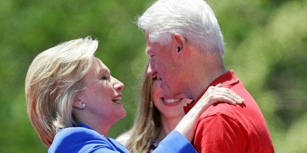 Democratic presidential candidate, former Secretary of State Hillary Rodham Clinton, left, hugs her husband former President