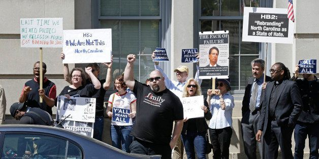 Opponents of House Bill 2 protest across the street from the North Carolina State Capitol in Raleigh, N.C., Monday, April 11,