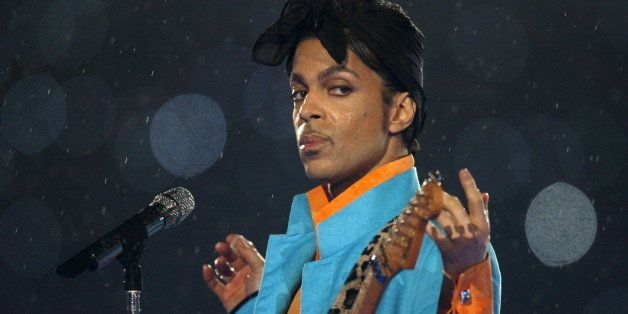 Prince performs during the halftime show of the NFL's Super Bowl XLI football game between the Chicago Bears and the Indianap