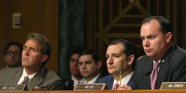 WASHINGTON, DC - JULY 21: (L-R) Senators Jeff Flake (R-AZ), Ted Cruz (R-TX) Mike Lee (R-UT) and John Cornyn (R-TX) listen to