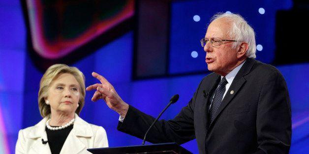 Democratic presidential candidate Sen. Bernie Sanders, I-V.t, right, speaks as Hillary Clinton listens during the CNN Democra