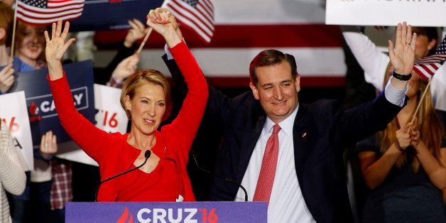 Republican U.S. presidential candidate Ted Cruz raises the arm of his running mate Carly Fiorina at a campaign rally where he