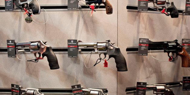 Revolvers sit on display in the Smith & Wesson booth on the exhibition floor of the 144th National Rifle Association (NRA) An
