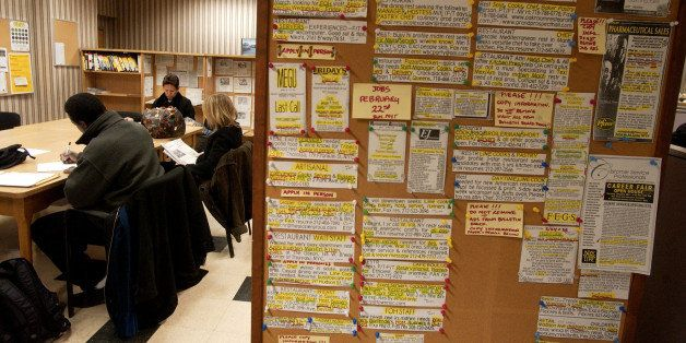 UNITED STATES - FEBRUARY 25:  Job postings hang on a wall near a table of job seekers in a New York State Labor Department ca