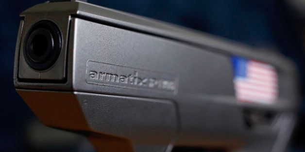 A smart gun by Armatix is pictured at the Armatix headquarters in Munich May 14, 2014. The gun is implanted with an electroni