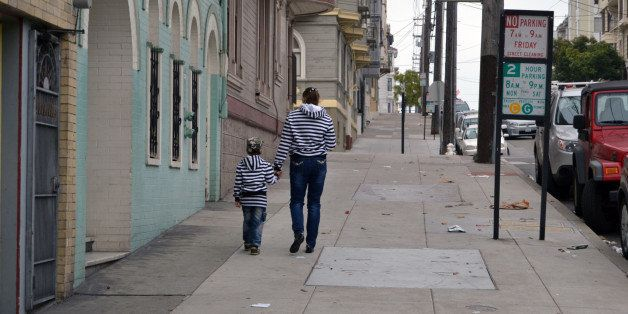 little girl and boy are walking on the street
