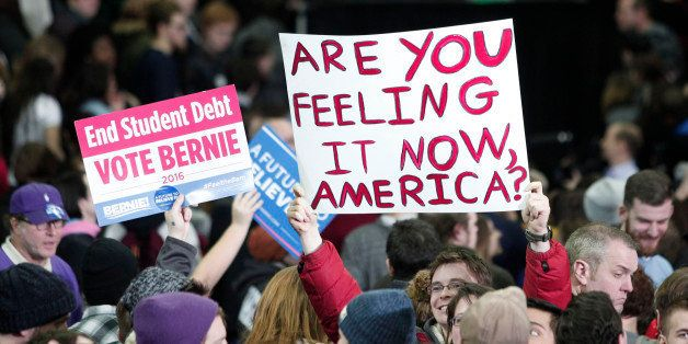 YPSILANTI, MI - FEBRUARY 15:  Supporters of U.S. Senator and Democratic Presidential Candidate Bernie Sanders  hold signs at