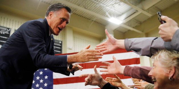 Former Republican presidential candidate Mitt Romney meets with attendees at a Republican presidential candidate, Ohio Gov. J
