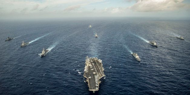 Waters East of Okinawa, July 30, 2014 - The aircraft carrier USS George Washington (CVN 73) and ships from the U.S. Navy, the