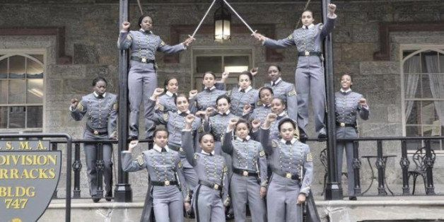 This undated image taken from Twitter shows  16 black, female cadets in uniform with their fists raised while posing for a ph