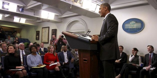 U.S. President Barack Obama answers a reporter's question after delivering a statement on the economy in the press briefing r
