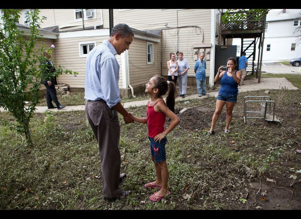 President Barack Obama greets a girl while touring a neighborhood affected by Hurricane Irene in Wayne, N.J., Sept. 4, 2011.